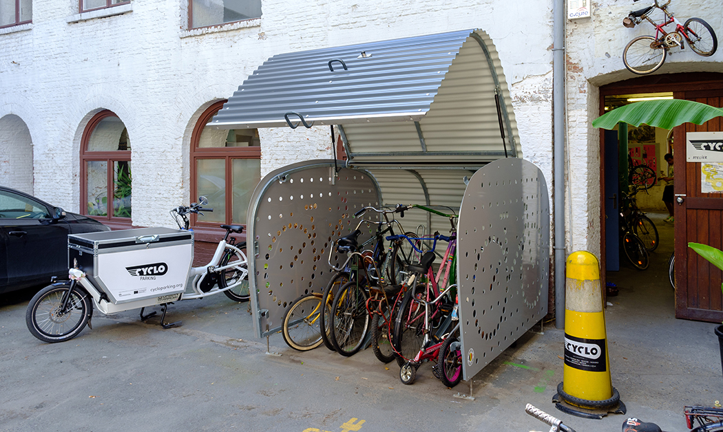 bikes in a box in front of the offices of the non-profit organisation CyCLO