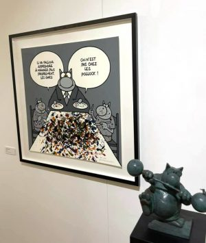 A drawing and figurine of the Ph. Geluck's Le Chat, shown in the exhibition
